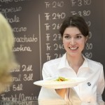 ISS employee serving a customer