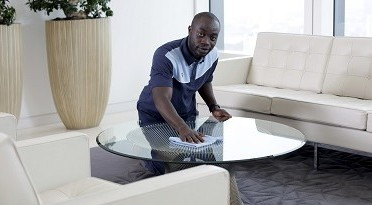 Refugee cleaning a table