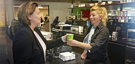 Worker serving food from a counter