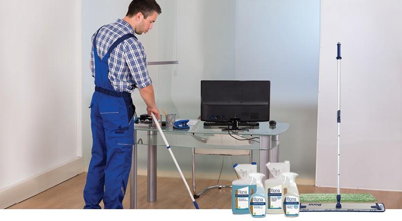 Worker cleaning hardwood floors