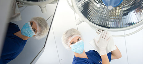 Worker cleaning health-care equipment