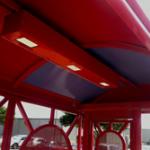 Vandal-resistant LED fixtures in solar-powered bus terminal