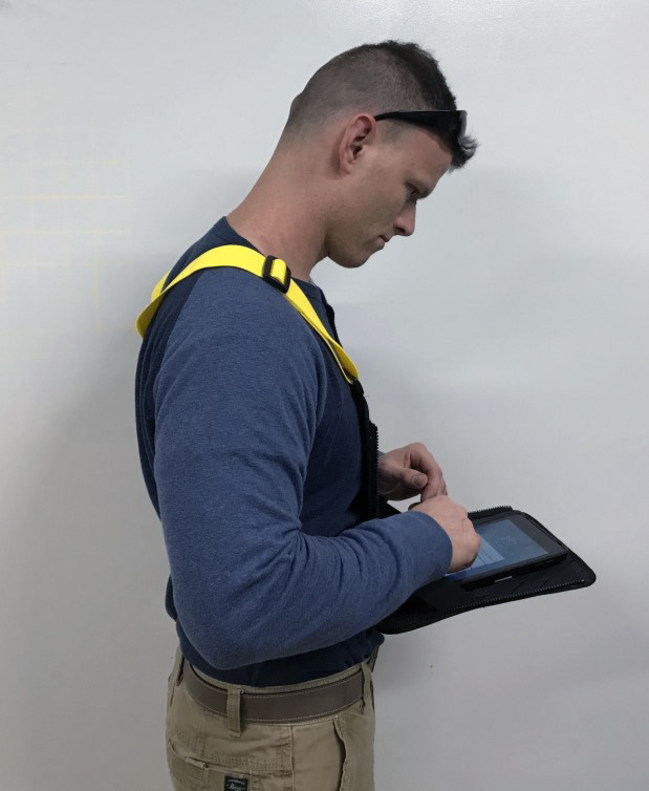 Safety vest with pull-down computer tablet surface