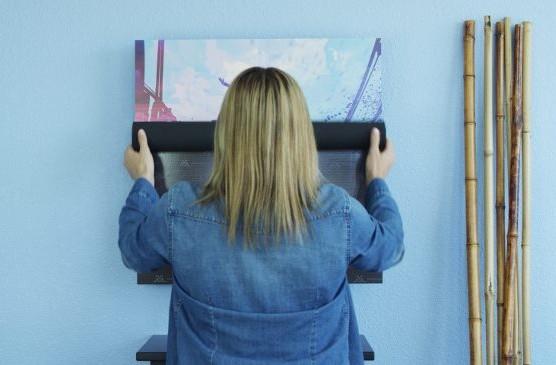 Woman rolling art covering onto speaker