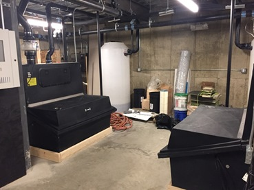 Figure 1-The two composting chambers in the basement of the Hitchcock Center for the Environment. The facility uses only composting toilets, which reduces water demand by around 65% .