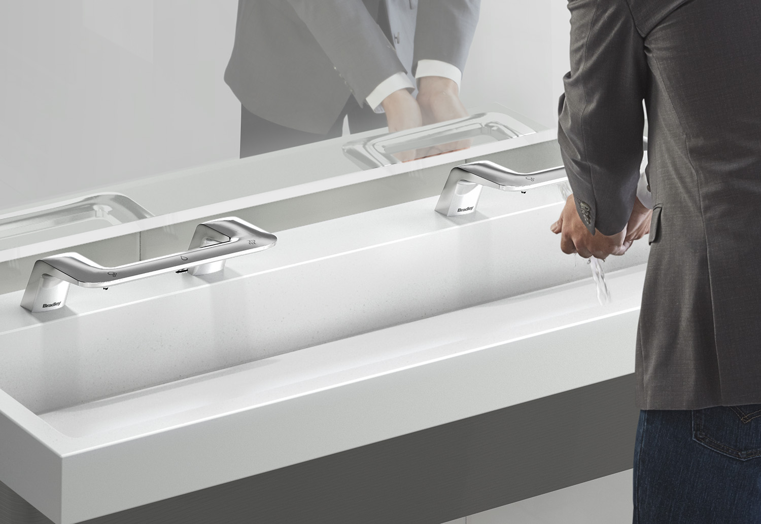Closeup of sink with touchless faucet system