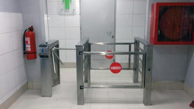 Trilock 60 turnstiles in front of men's restroom
