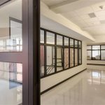 Interior window wall assemblies with fire resistive frames in a school