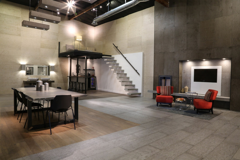 Showroom with concrete floor planks and wall panels