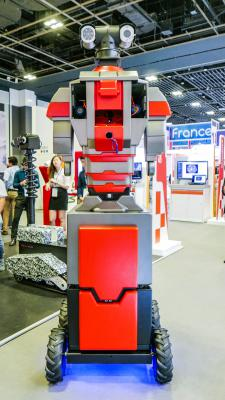 Tall red-and-gray security robot