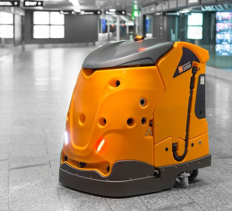 Orange robotic floor-care machine