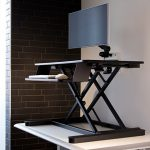 ESI ergonomic sit-to-stand workstation on table