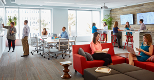 In this Workshop Setting, employees work simultaneously on various parts of a project—sketching ideas on a whiteboard, reviewing construction plans at a standing-height table, and breaking away from the group to have private conversations.
