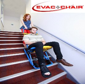 One person pushing another down stairs in a mobile evacuation chair