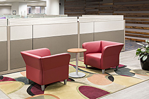 Team members gravitate to a variety of huddle areas that facilitate communication.
