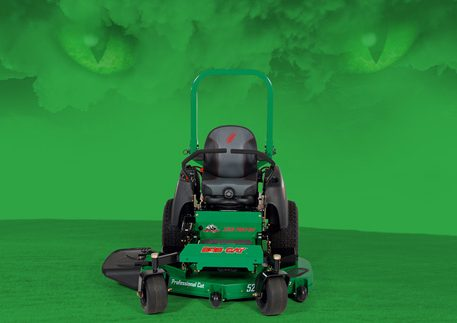 Aggressive-looking black-and-green riding mower with green eyes and cloud above