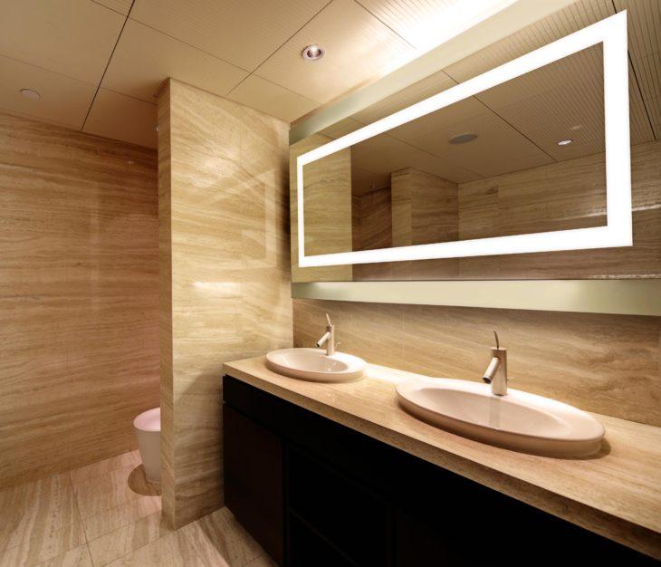 Back-lit mirror in a restroom