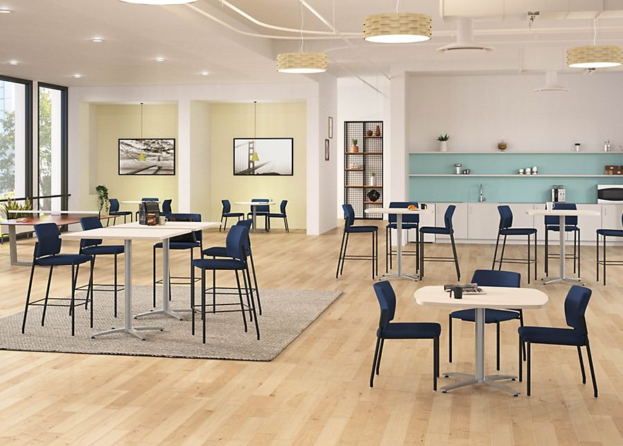 Standing- and sitting-height white tables with blue chairs in a café setting