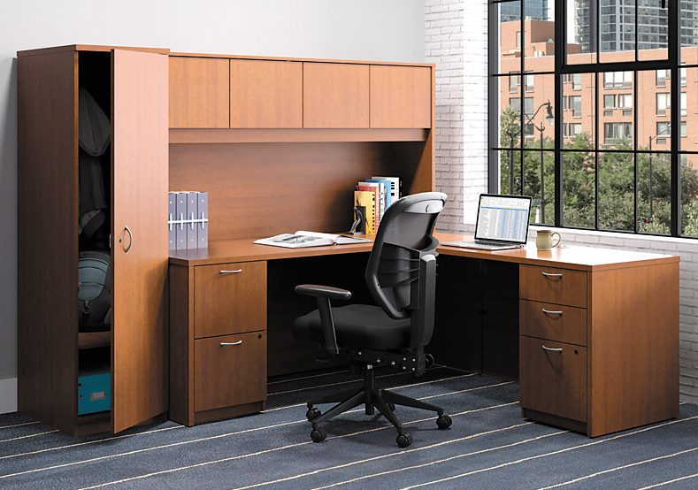 Cherry-colored desk surrounded by storage units