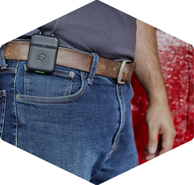Alert device clipped to a worker's belt