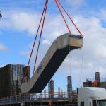 Elevator system being hoisted at the arena construction site
