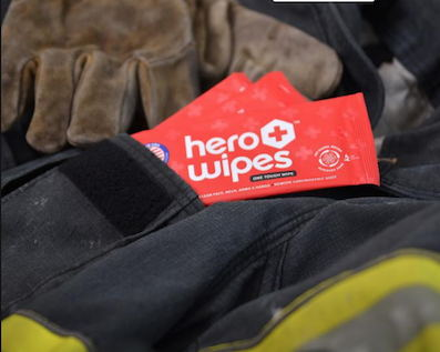 Red packages of decontamination wipes in an EMS worker's pocket