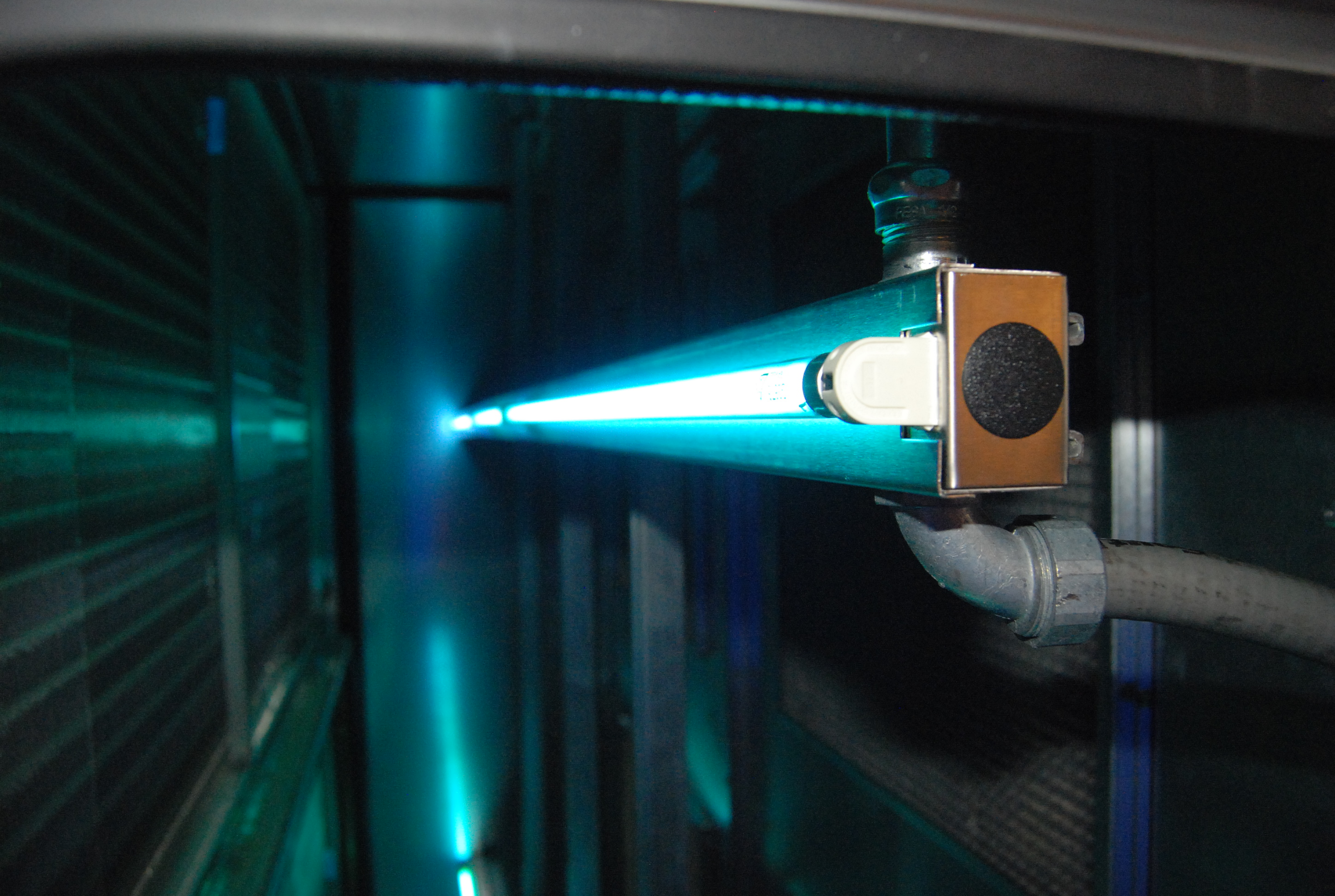 A glowing blue UV-C light tool