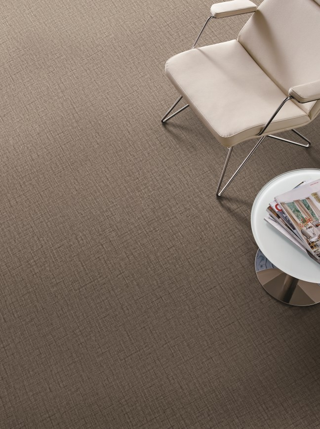 Textured-looking vinyl flooring with a chair and table
