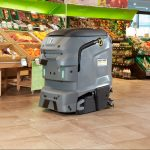 Robotic scrubber dryer cleaning a grocery store floor