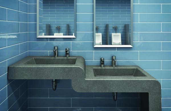 Grey 2-level sinks in restroom with light blue tile