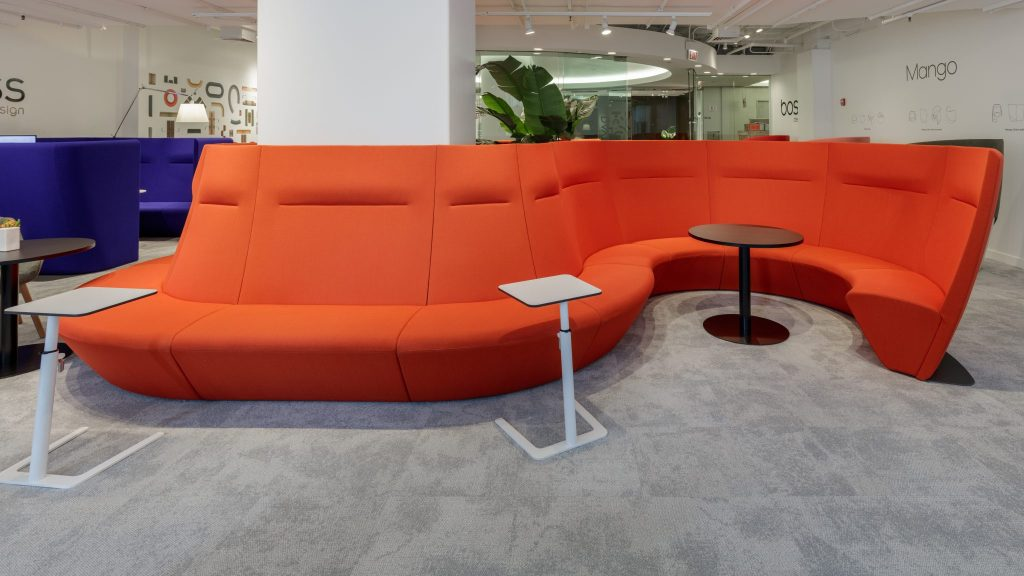 Orange high-back curved soft benching with small tables