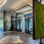 Coworking space with green walls, private booths