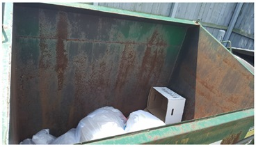 Figure 2. Recycling container, less than 1/4 full. Note the unflattened box, taking up airspace.