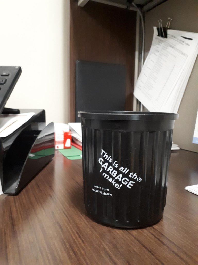 Personalized desktop trash pails encourage East Port tenants to recycle.