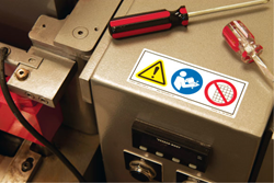 Safety sign with symbols on equipment