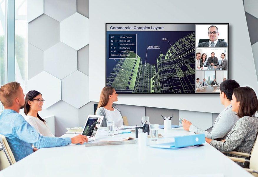 Group at a conference table looking at Sharp new 4K Ultra-HD digital display