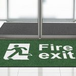 """Green floor mat from First Mats with """"Fire Exit"""" safety message"""