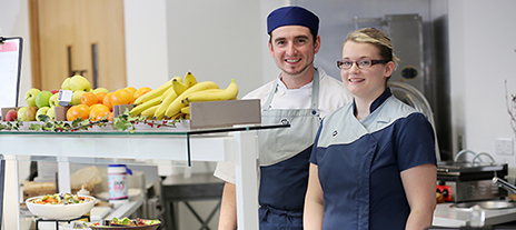 Two ISS food services employees