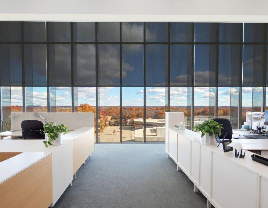 Mecho SolarTrac 4.0 window shades in an office space