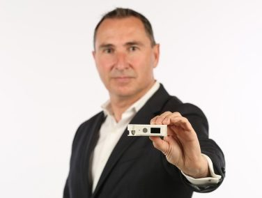 Amber CEO holds solid-state smart circuit breaker