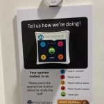 Microshare's IoT sensor and button on wall pad in restroom to alert FMs of issues