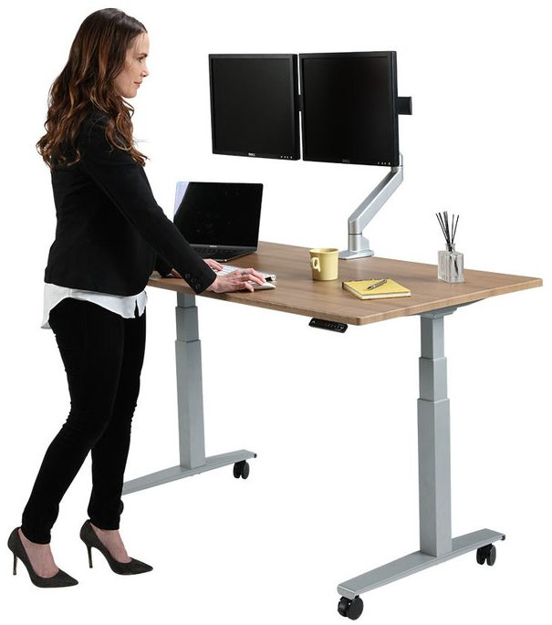 Female worker by a Howard Miller SmartMoves custom adjustable-height desk