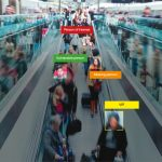 Video image of IDEMA's Augmented Vision video analytics solution identifying people on a moving sidewalk