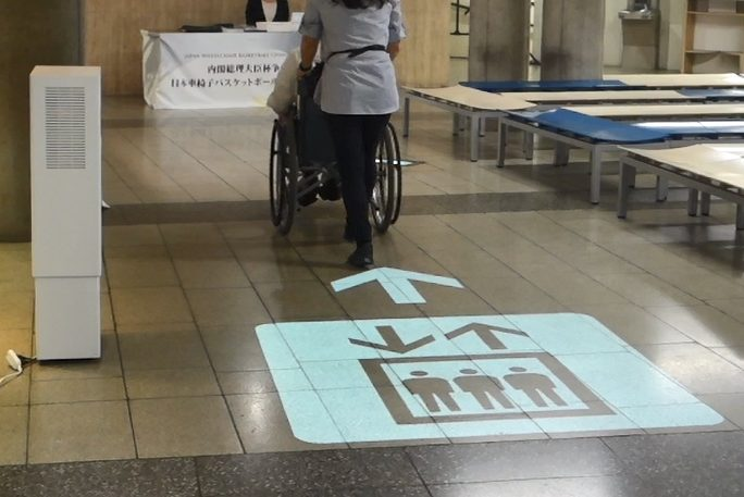 Mitsubishi Electric dynamic sign projected onto floor