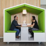 2 people meeting in a Nook Pod with Proximity software