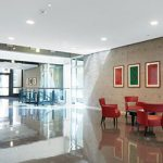 Armstrong's ACOUSTIBuilt Seamless Acoustical Ceiling system in a lobby