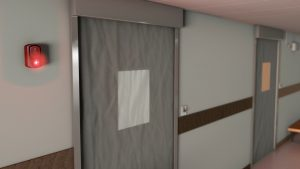 Fire curtain with vision panel and fire alarm. Photo provided by BLE Smoke and Fire Curtains.