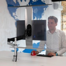 R-Go Hygienic Safety Screen Partition mounted on a monitor arm