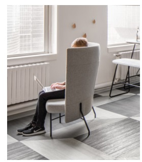 Figure 1. Consider how products can provide privacy while also communicating occupancy. This seat is providing some privacy for the user while also allowing others to know that the chair is occupied.