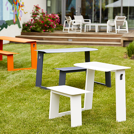 Landscape Forms Take-Out attached-seating table collection for outdoor spaces